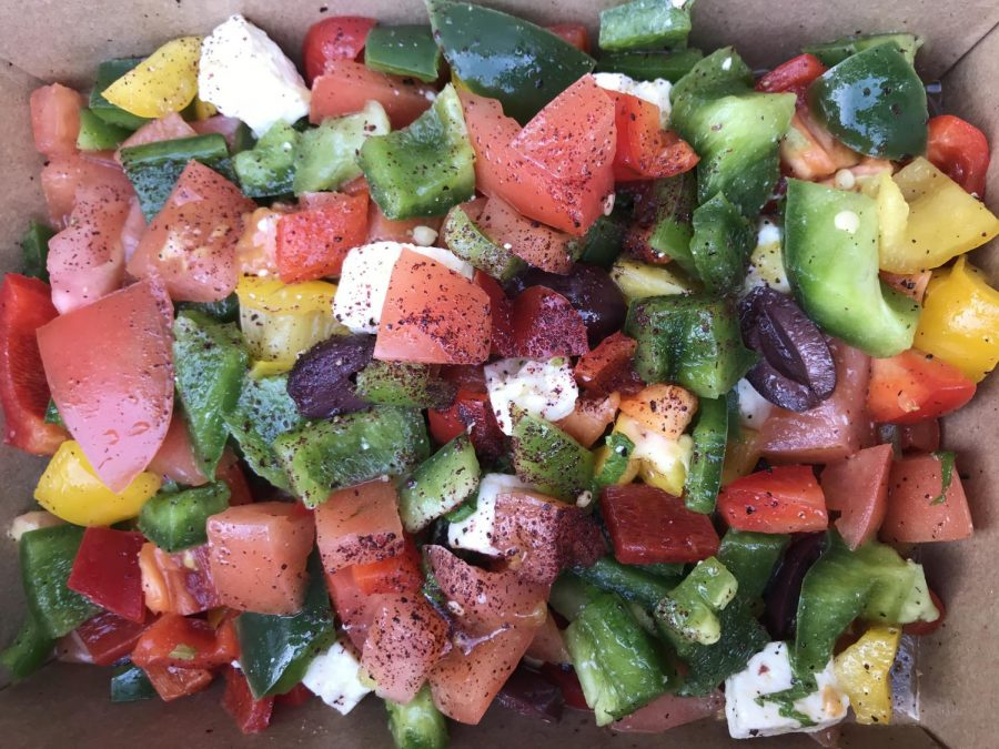 A+serving+of+Greek+Salad+made+from+bell+peppers%2C+tomatoes%2C+kalamata+olives%2C+feta%2C+and+cucumber+from+Zaina%27s+Bellini+Cafe.