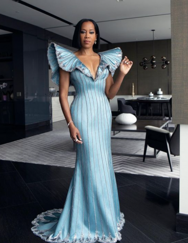 Regina King wearing a light blue Louis Vuitton gown with silver details.