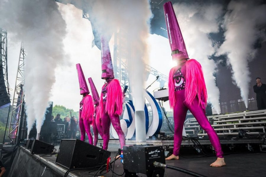 The band Empire of the Sun wearing original second-hand pink costumes with pointy pink hats made by designer Svetlana Shigroff.