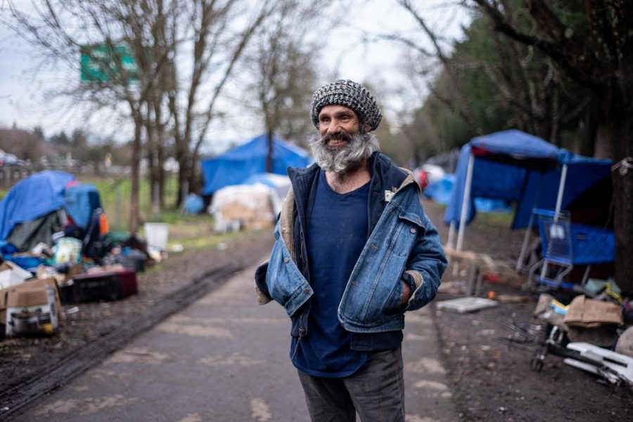 Seth Hagedon, the self-appointed comedian of the Joe Rodota Trail homeless community, admires the artistic spirit and energy along the trail and thinks many of the residents are happy to live on the street.