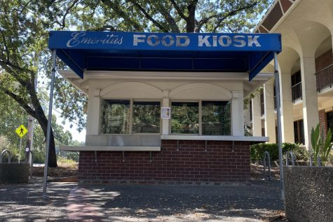 The blue-roofed and red brick kiosk has windows and counters where students can pick-up their food and beverages.